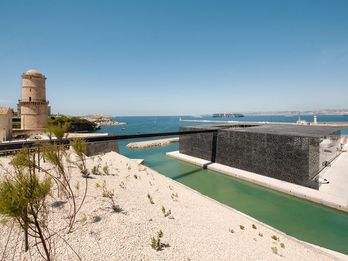 At the outer point of the Old Harbor, the dark color of MuCEM